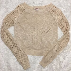 Thin knitted sweater.
